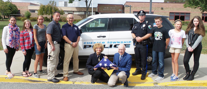 "Integrated Language Arts teachers Joseph S. Pizzo and Doreen Aiello (center), pictured with seventh graders and Chester and NYNJPA police officers outside Black River Middle School.  The students work with the police during their study of the novel, ""The Outsiders."""