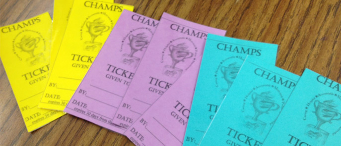 Students receive tickets for good behavior.