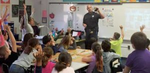 Berkeley Township Police Officer Scott Selby teaches a DARE lesson to a grade 5 class at Berkeley Township Elementary School. A township police officer is in each of the district's four schools every day.