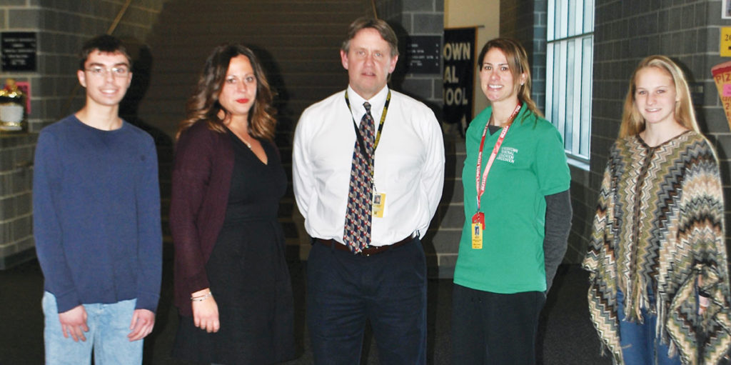 Left to right: Grand-prize winner James Caci; NJM's Consumer Safety Coordinator Erica Rosso; Rob Walder, Bordentown Regional High School principal; Erica Wright, driver's education teacher, grand-prize winner Morgan Papp.