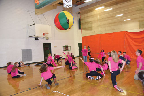 "Team-building games create friendships. Here, the Pink Team plays ""Nitro River."""