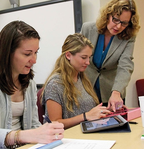 Training for special education teachers is a focus of Monmouth University. Above, Dr. Wendy Harriott, associate dean of the School of Education, works with students.