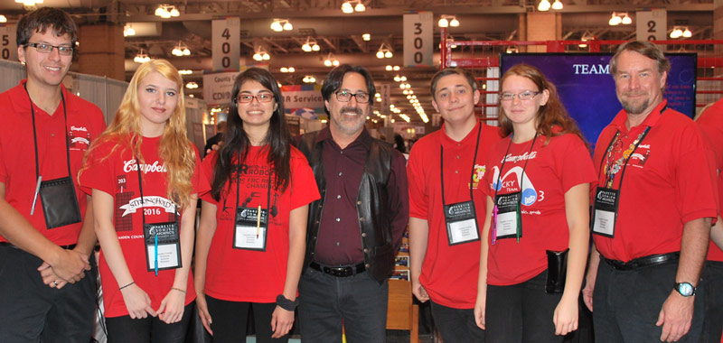 Keynote speaker Fredi Lajvardi, a noted STEM educator, with the members of the Camden County Technical Schools Robotics team.
