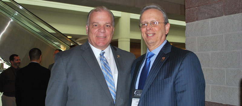 At the Legislative Update panel, Dr. Lawrence S. Feinsod, NJSBA executive director, pictured at right, with state Senate President Steve Sweeney.