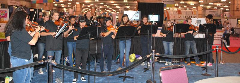 The Hunterdon Central Regional High School Fiddle Club performed on the Exhibit Hall floor.