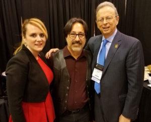 Left to right, Acting Commissioner Kimberley Harrington; keynote speaker Fredi Lajvardi; and NJSBA Executive Director Dr. Lawrence S. Feinsod.