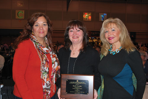 After receiving her Board Member of the Year Award at Workshop, Sheli Dansky (center) with River Edge Board President Paris Myers (left) and Dr. Tova Ben-Dov, superintendent (right).
