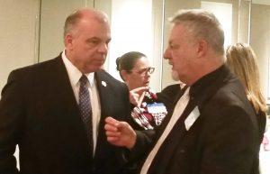 New Jersey Senate President Steve Sweeney, at left, talks with Michael Vrancik, NJSBA director of governmental relations.