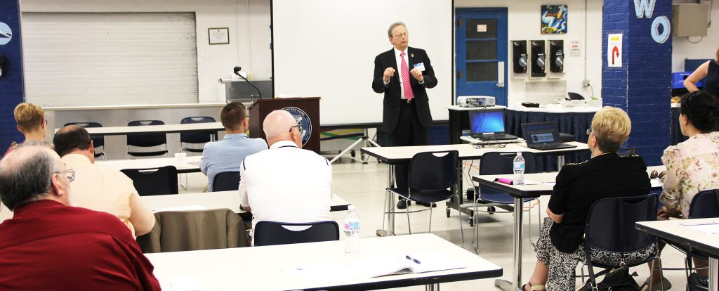 """NJSBA Executive Director Dr. Lawrence S. Feinsod addressed attendees at the program, """"Advocating for Your District's Funding,"""" held at West Orange High School."""
