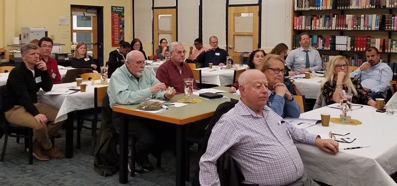 Board members listen to a presentation on advancements in school law presented by NJSBA counsel John Burns (not pictured).