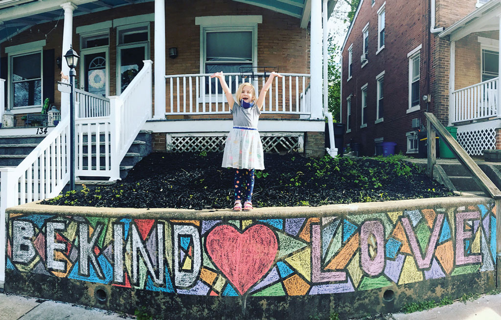 "Spreading Love in Haddonfield As part of an elementary school principal's challenge to draw something that depicts ""love,"" one first-grader in Haddonfield shows off a chalk drawing in front of her house."