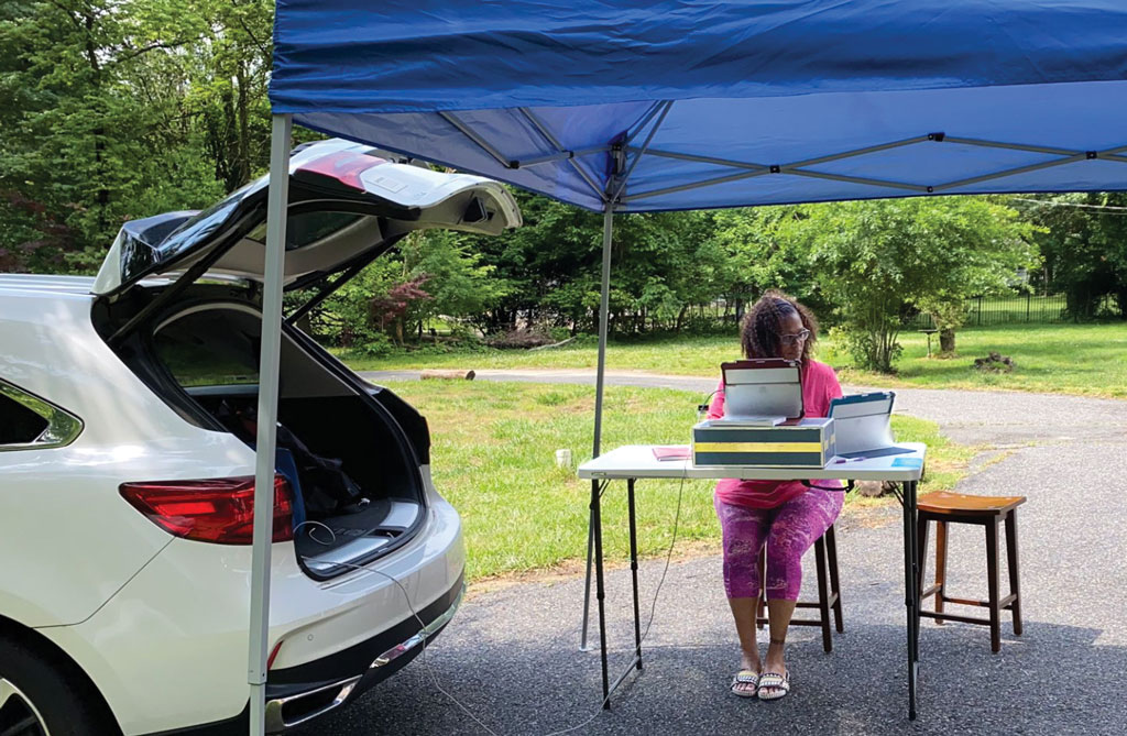 No Power? No Problem Dr. Carmen Henderson, the incoming director of special education in Haddonfield, did not allow a power outage to prevent her from reaching out to students and families. She put up a tent in her driveway, connected her laptop to her car and kept working.