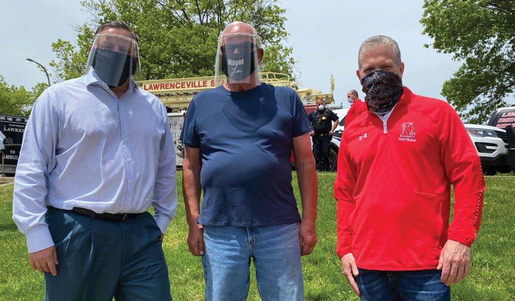 Face Shields for Municipal Workers Displaying face shields made for township municipal employees on Lawrence Township school district 3-D printers, left to right, Kevin Nerwinski, township manager, Jim Kownacki, mayor, and Dr. Ross Kasun, superintendent.